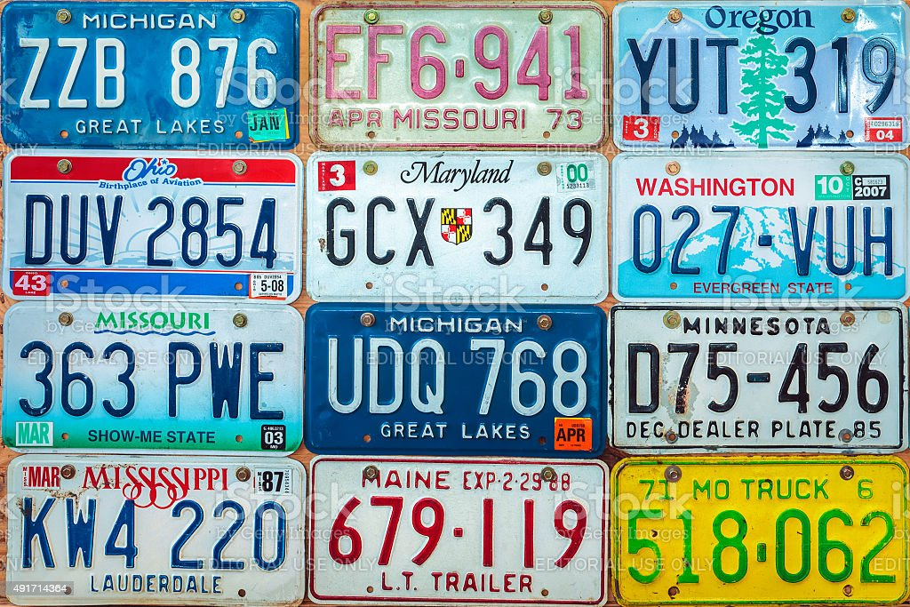 Vintage car license plates on a wall stock photo