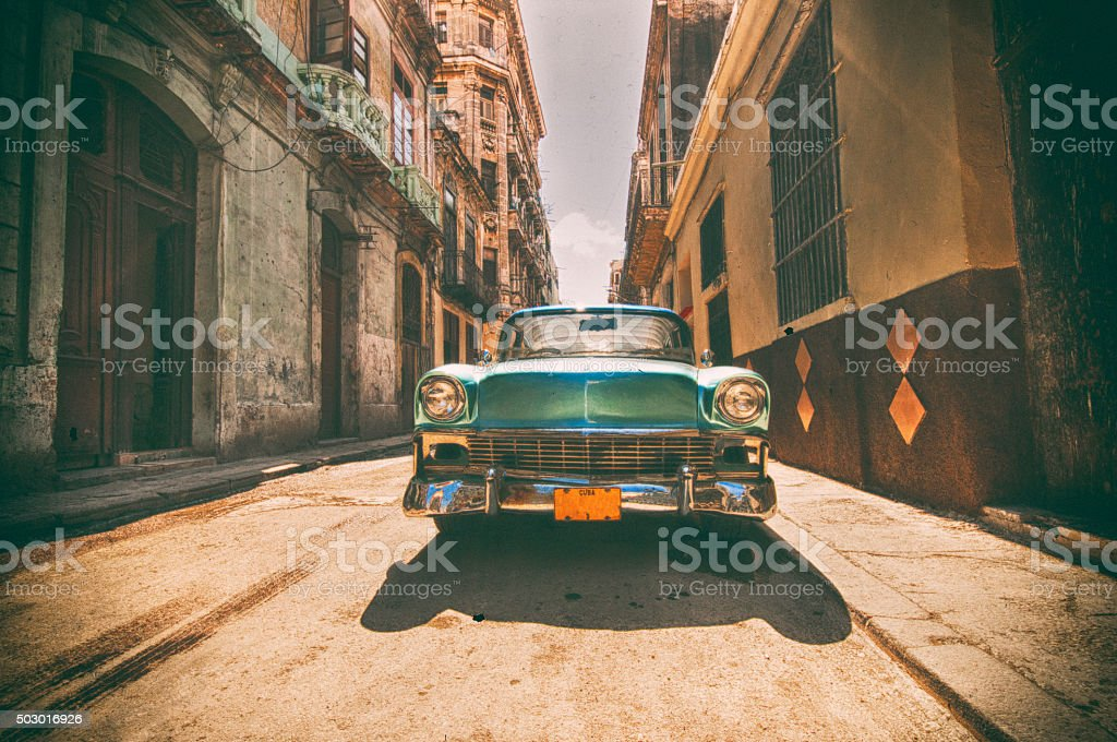 Vintage car parked in Havana street Retro style image with vintage american car parked on a street in Old Havana 2015 Stock Photo