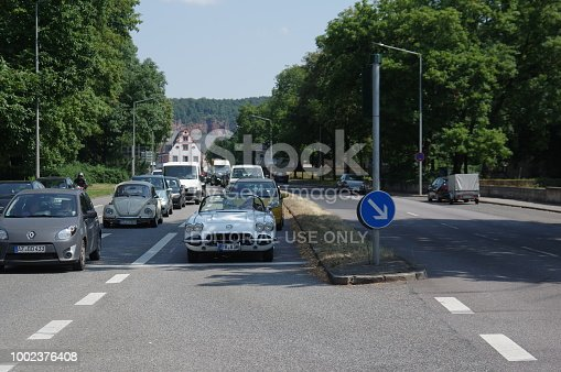 Trier, Germany, - July 14, 2018. Vintage sports car crossing the street on a warm summer day.