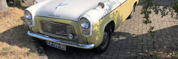 Vintage car Nuth, the Netherlands - August 23, 2018. Vintage  car parked near the street on a warm summer day. 1960 1969 stock pictures, royalty-free photos & images