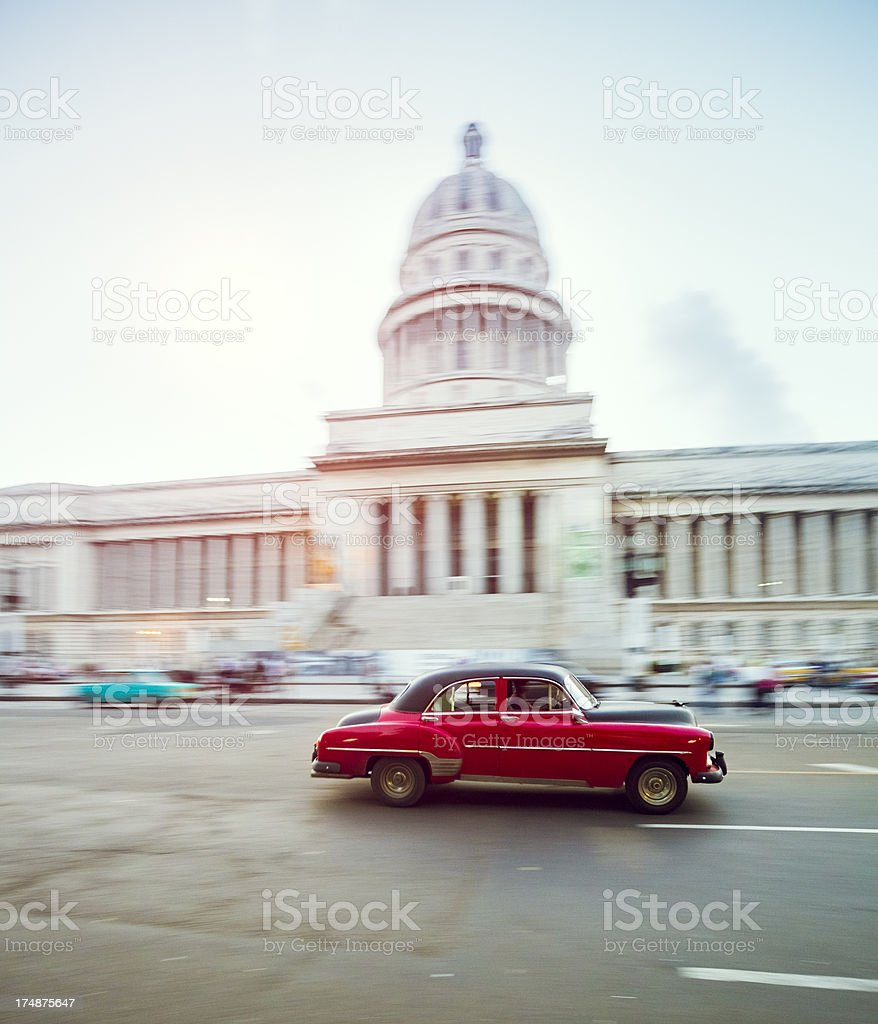 Vintage car speeding in front of Capitol in Havana, Cuba stock photo