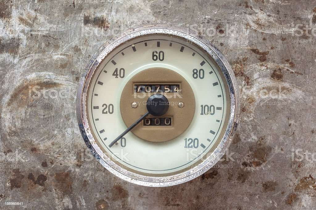 Vintage car speedometer on a rusty background royalty-free stock photo