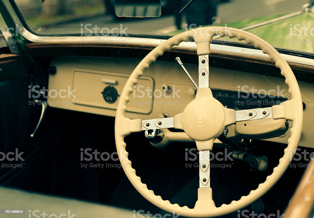 Vintage car steering wheel and dashboard royalty-free stock photo