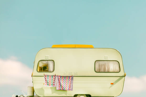 Vintage caravan with towel and curtains stock photo