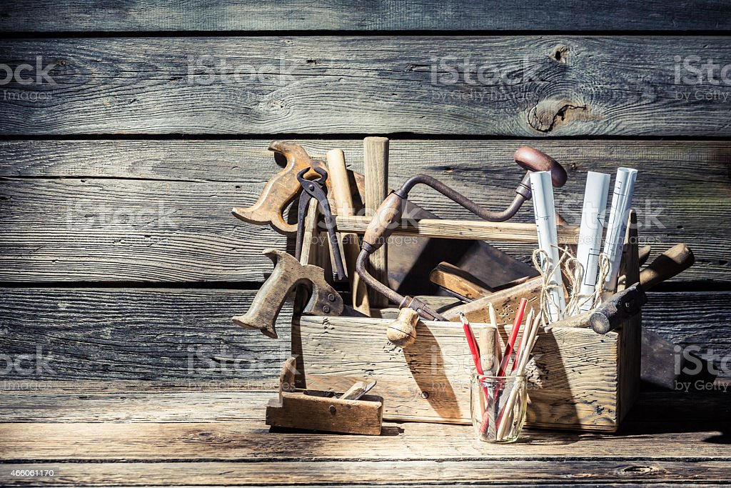 Vintage carpenter tools in a toolbox stock photo