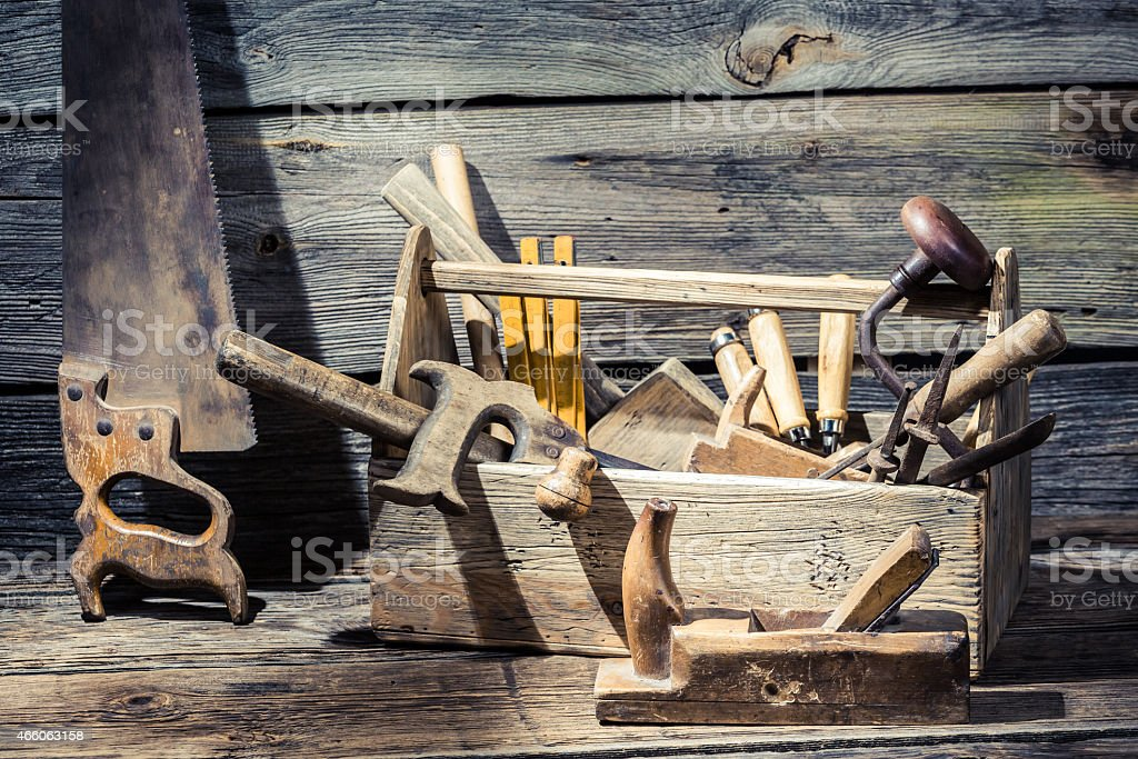 Vintage carpenter tools in a wooden box stock photo