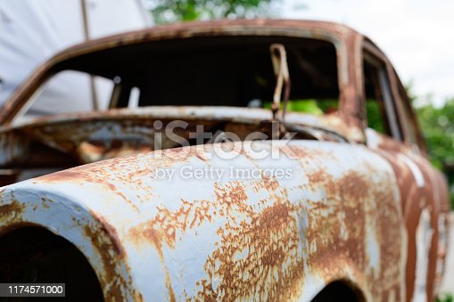 Vintage cars abandoned and rusting away.