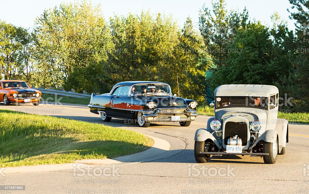 Vintage Cars Cross Bridge In Classic Car Cruise Parade stock photo