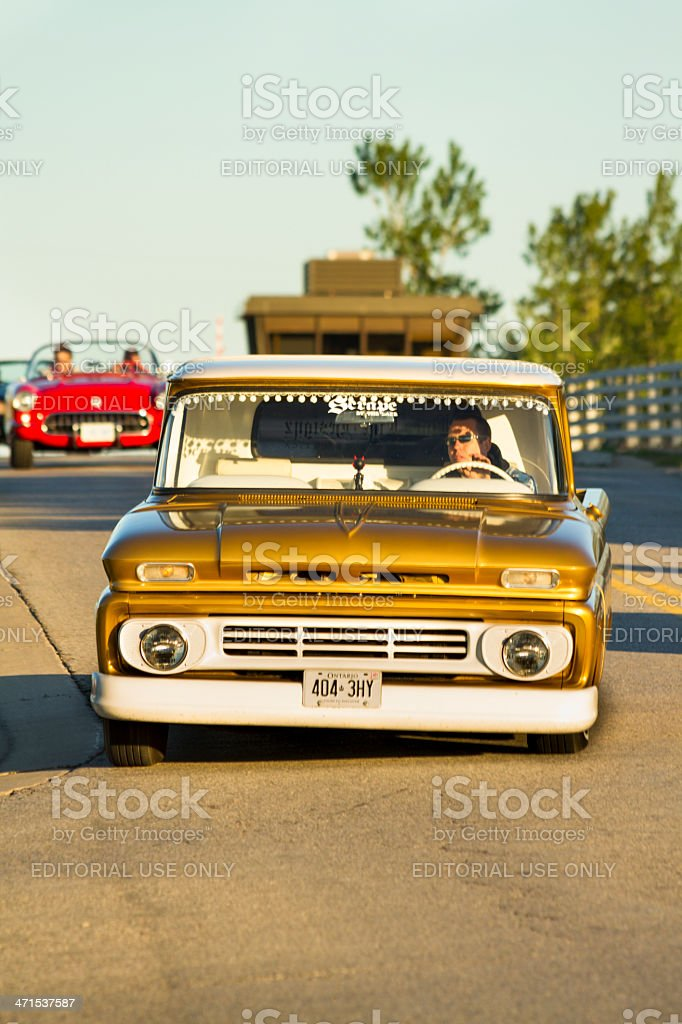 Vintage Cars Cross A Bridge In A Classic Car Cruise Parade. OLG...
