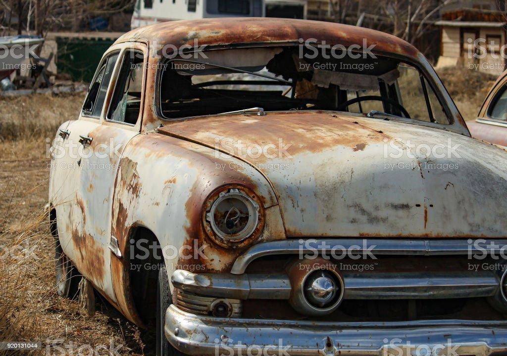 Vintage Cars In A Junkyard stock photo | iStock