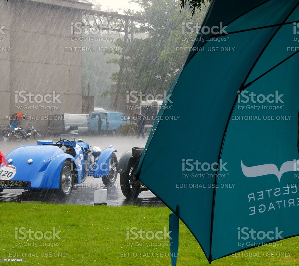 Vintage cars in the rain stock photo