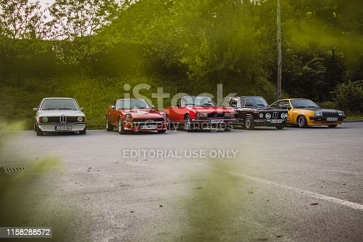 Polhov Gradec, Slovenia, 25.6.2019: A group of old vintage cars, including Datsun 240Z, Opel Manta B, Peugeot 504 and Bmw E21 325 and 2002 tii, waiting to start the ride.