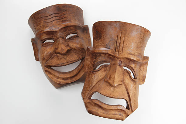 vintage carved wood art, of comedy and tragedy theatre masks - tragedy mask stock photos and pictures