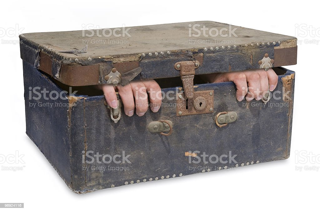 Vintage case with a claustrophobic person inside royalty-free stock photo