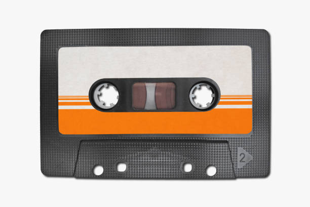 Vintage cassette tape Close-up on a cassette tape isolated on white background. audio cassette stock pictures, royalty-free photos & images
