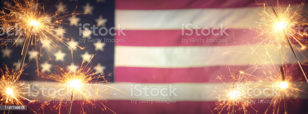 Vintage Celebration With Sparklers And Defocused American Flag - 4th Of July Vintage Celebration With Sparklers And Defocused American Flag - 4th Of July Fourth of July Stock Photo