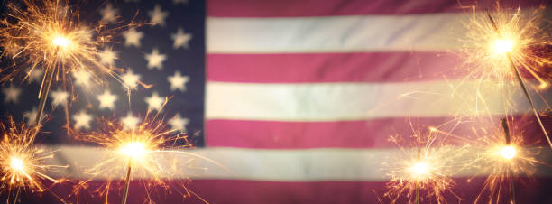 vintage celebration with sparklers and defocused american flag - 4th of july - independence day stock pictures, royalty-free photos & images