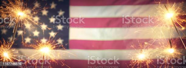 Vintage Celebration With Sparklers And Defocused American Flag 4th Of July Stock Photo - Download Image Now