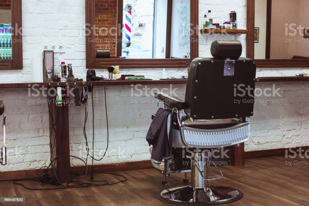 Vintage chair in barbershop stock photo