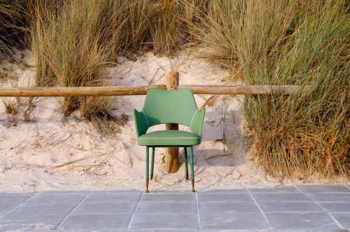 Vintage chair at the beach