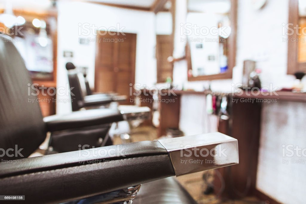 Vintage chairs in barbershop stock photo
