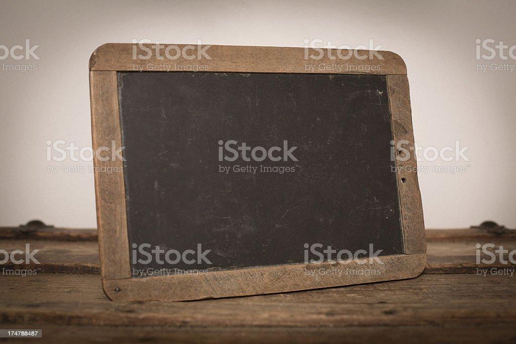 Vintage Chalkboard Slate Sitting on Trunk royalty-free stock photo