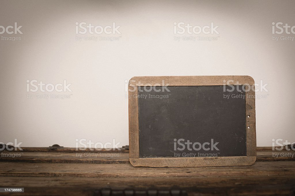 Vintage Chalkboard Slate Sitting on Trunk, With Copy Space royalty-free stock photo