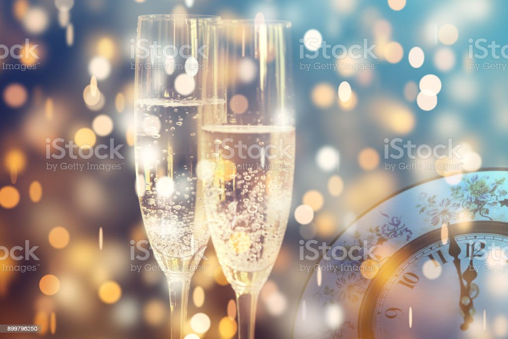 Vintage champagne glasses and midnight clock. Happy New Year stock photo