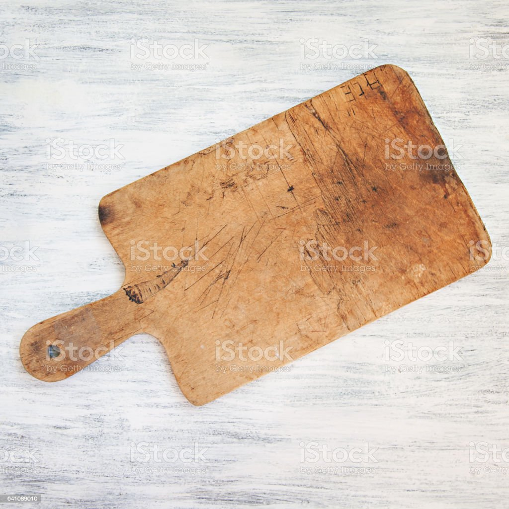 Vintage Chopping Board on White Table stock photo