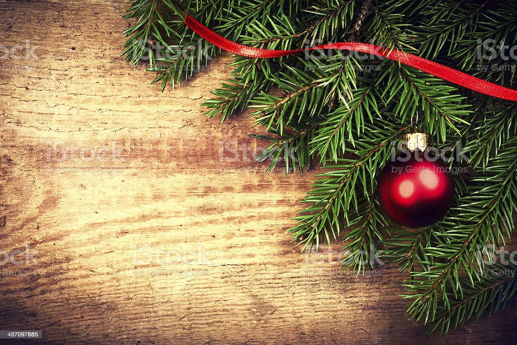 Vintage Christmas Background with Tree Branch on wooden backgrou royalty-free stock photo