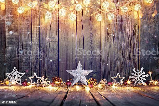 Vintage christmas card with lights and star on table picture id611178924?b=1&k=6&m=611178924&s=612x612&h=i8fqkeh tebgcfrtltvhafgebayavdbblenq3uq2mmu=