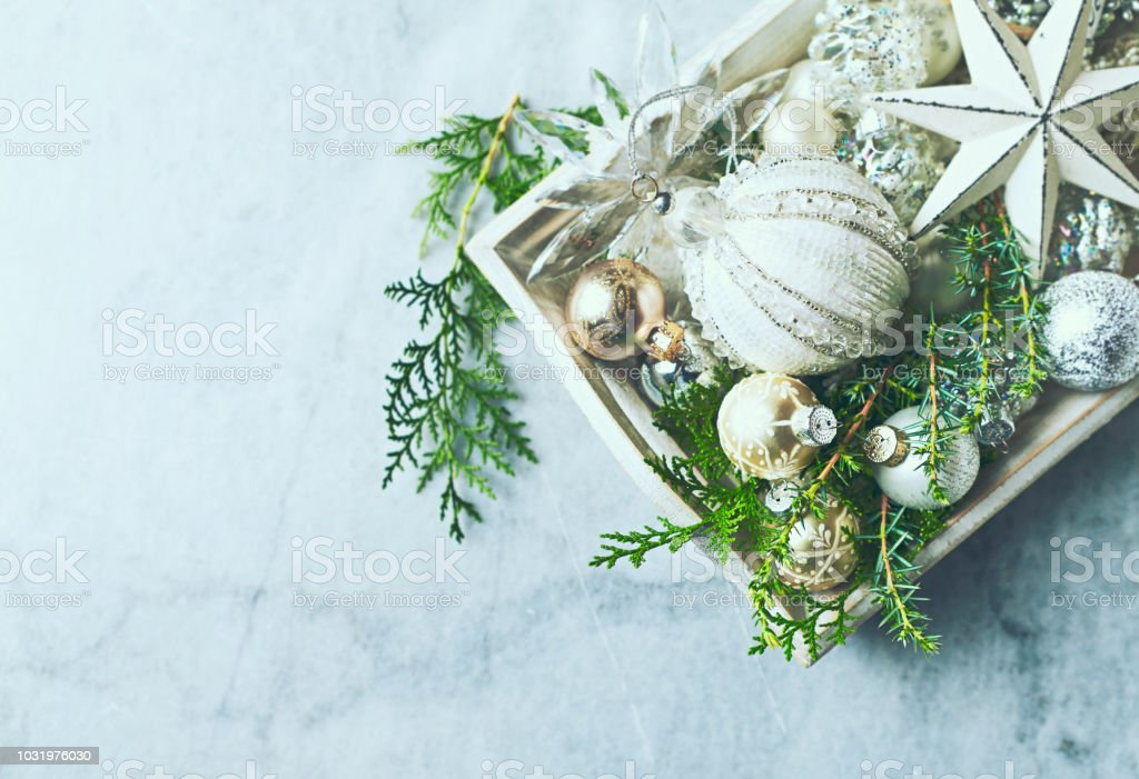 Vintage Christmas Decorations and Evergreen Twigs on a rustic wooden tray. Flatlay. Symbolic image stock photo