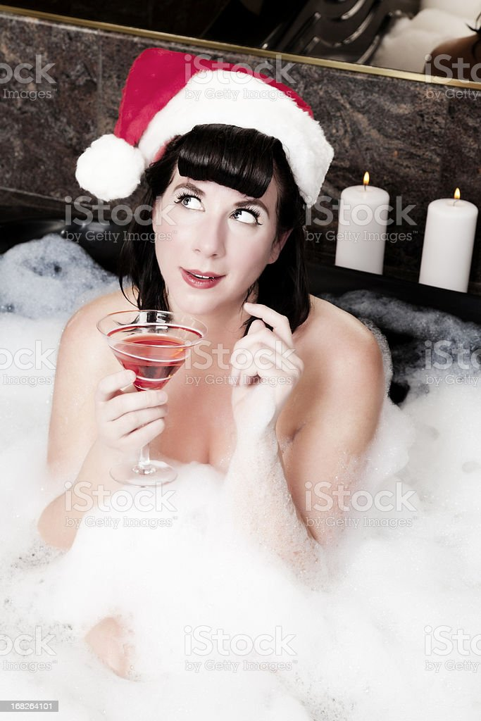 Vintage Christmas: sexy pin-up girl making a wish royalty-free stock photo