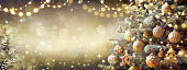 istock Vintage Christmas Tree With Retro Ornament And Golden Shiny Glitter In The Defocused Background - Toned Filter 1284599467
