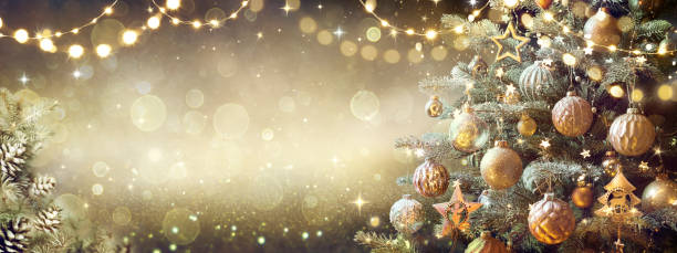 Vintage Christmas Tree With Retro Ornament And Golden Shiny Glitter In The Defocused Background - Toned Filter stock photo