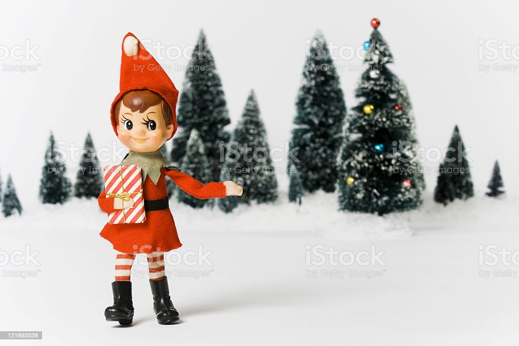 Vintage Christmas with toy elf and gift stock photo