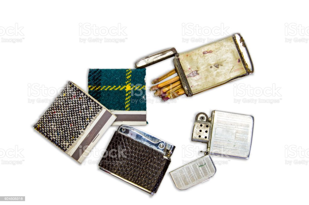 Vintage cigarette lighters, books of matches and a match safe stock photo