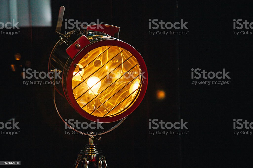 Vintage cinema hot light on black stock photo