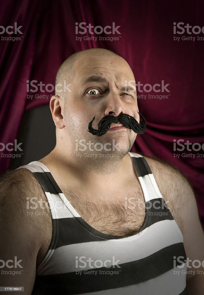 Vintage circus strongman with big mustache stock photo