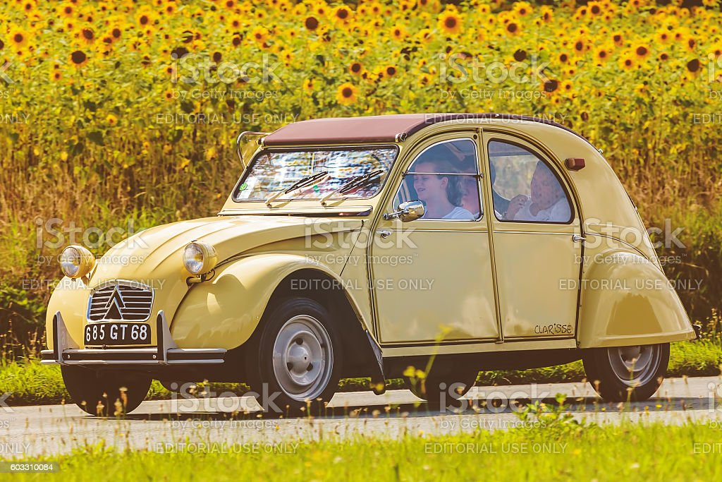Vintage Citroen 2CV in front of blooming sunflowers - Photo