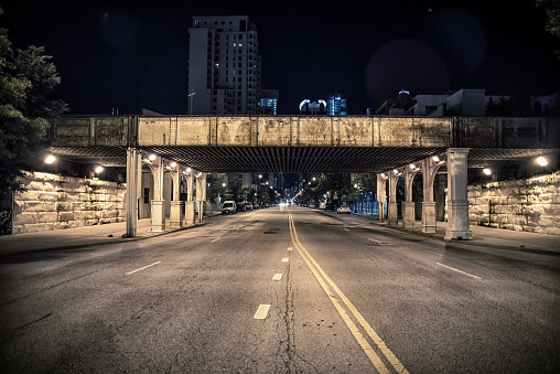 Vintage city railroad bridge at night
