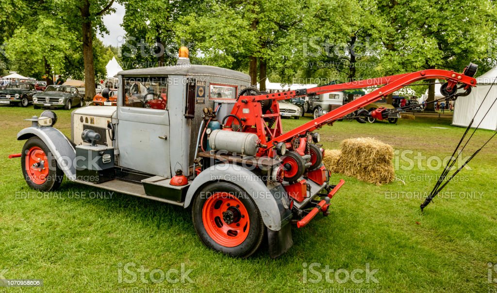 Vintage classc tow truck parked in a field stock photo