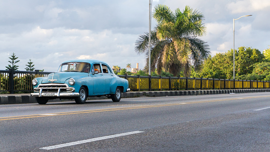 Havana, Cuba-December 2017: Vintage classic American car on the street used for transportation and tourism services, decorating driveways and parking lots, making Cuba an authentic county to visit.