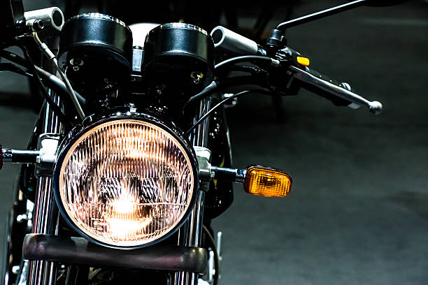 vintage classic motorcycle head light - motorcycle stock photos and pictures