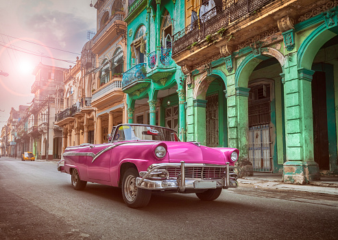 Vintage classic pink american oldtimer convertible in old town of Havana Cuba