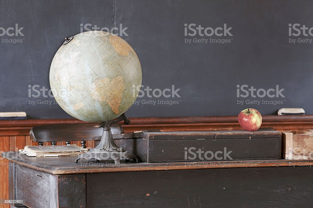 Vintage Classroom with Antique Desk and Blackboard stock photo