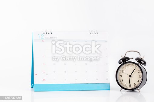 istock Vintage clock and calendar December on white background, time concept 1136737386