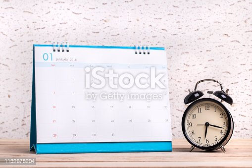 istock Vintage clock and calendar on wood, Time and planning concept 1132678204