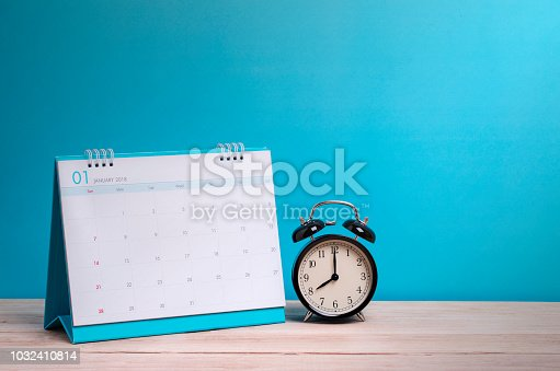 istock Vintage clock and calendar on wood, time concept 1032410814