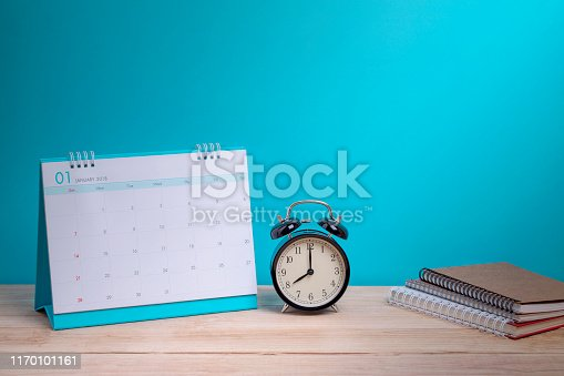 istock Vintage clock and calendar on wood, time concept 1170101161
